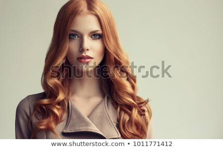 Beautiful girl with long red hair Stock photo © svetography