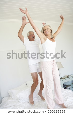 paar · springen · rond · bed · man · vrouwen - stockfoto © monkey_business