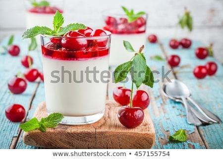 refreshing homemade panna cotta with cherries stock photo © mpessaris