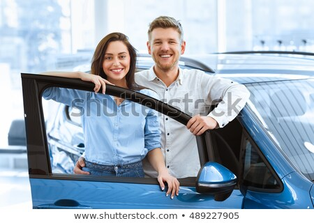 happy beautiful couple just bought a new car stock photo © deandrobot