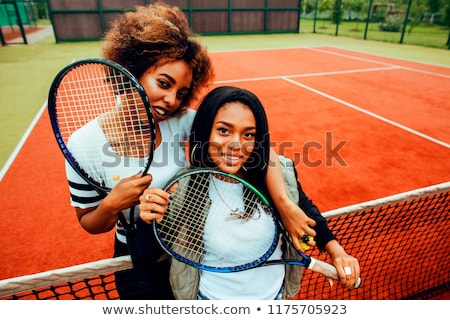 young pretty girlfriends hanging on tennis court, fashion stylis stock photo © iordani