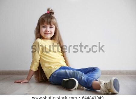 beautiful girl with long hair sitting on the floor stock photo © dmitriisimakov