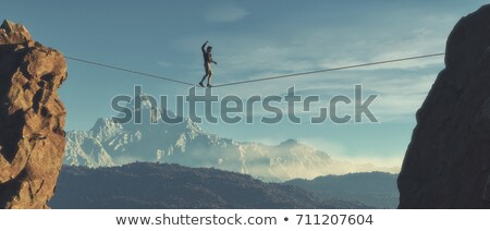 Young man walking in balance  Stock photo © orla
