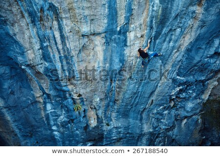 Climbers hands on a rock face. Stock photo © IS2