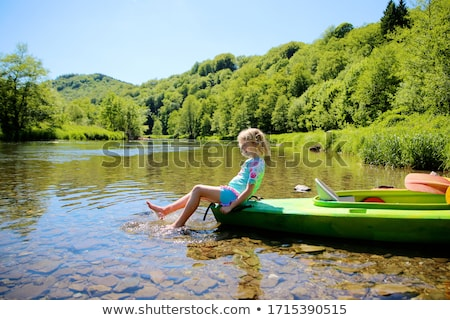 Young girl doing kayak on a river Stock photo © IS2