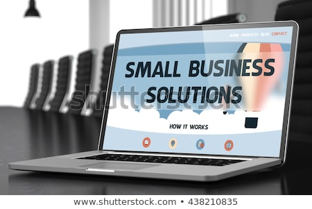 small business solutions on laptop in conference hall stock photo © tashatuvango
