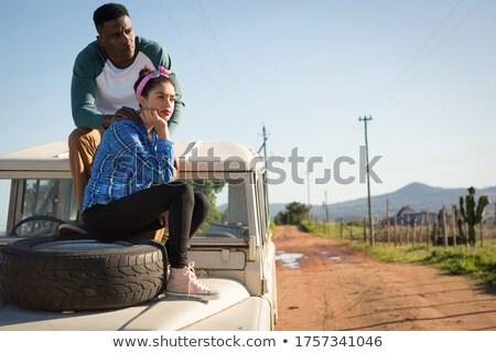 Stock photo: Romantic couple sitting on the bonnet
