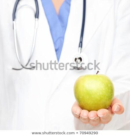 Femme blanche sarrau pomme infirmière portrait Photo stock © IS2