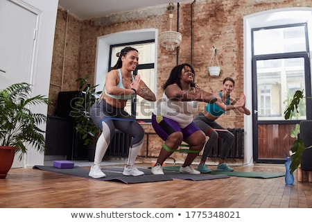 Full length of three fit women exercising with resistance bands  Stock photo © Kzenon