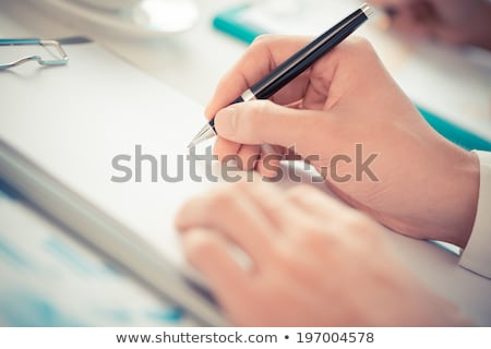 Stock photo: Reporter writing an article.