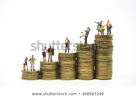 miniature woman and man on piles of euro coins Stock photo © nito