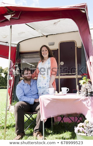 Couple picnicking outside trailer Stock photo © IS2