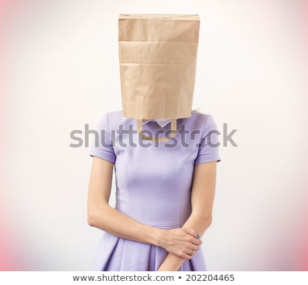 Young woman with paper bag with sad face over head Stock photo © IS2