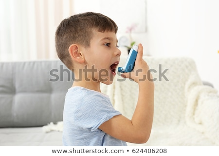 Boy using asthma pump Stock photo © wavebreak_media
