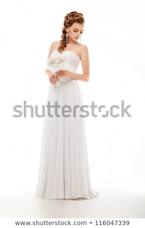 happy young bride posing in traditional white dress with wedding bouquet, isolated on white Stock photo © LightFieldStudios
