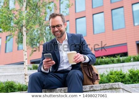 Homem maduro móvel ao ar livre negócio homem tecnologia Foto stock © IS2