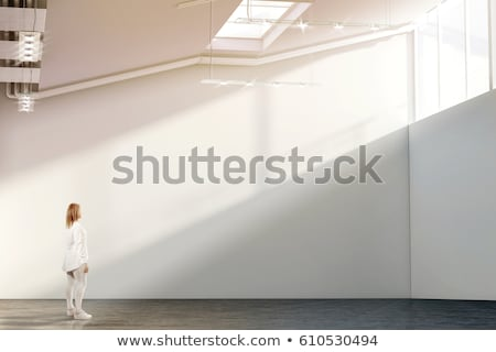 Woman standing and looking up loft. Stock photo © IS2