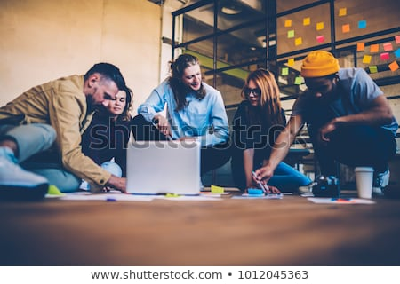 man and woman cooperating as co-workers in collaborative office  Stock photo © Kzenon