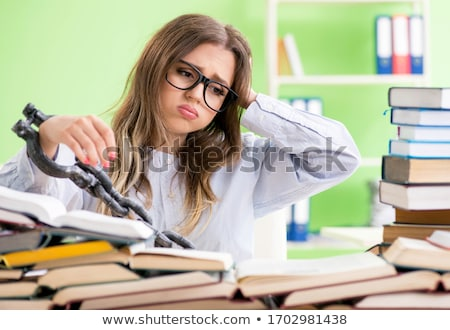 Young female student chained to the desk and preparing for exams Stock photo © Elnur