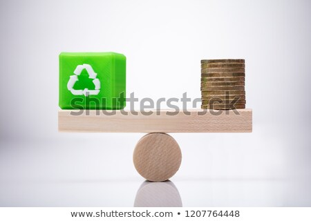 Cubic Block With Recycle Symbol And Coins Balancing On Seesaw Stock photo © AndreyPopov
