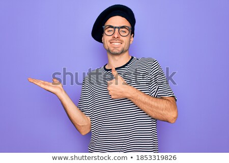 Attractive man in striped t-shirt smiling and showing ok sign, i Stock photo © deandrobot