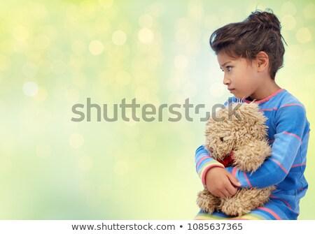 Triste bambina orsacchiotto verde luci infanzia Foto d'archivio © dolgachov