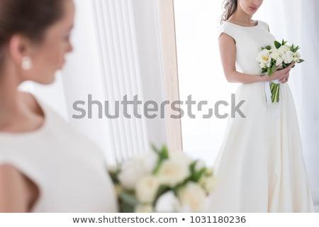 Robe de mariée miroir blanche mur lumière chambre Photo stock © fama