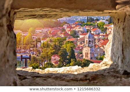 Town of Cavtat towers and waterfront view througf stone window stock photo © xbrchx