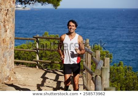 Mannen jogging dag tijd strand muziek Stockfoto © Lopolo