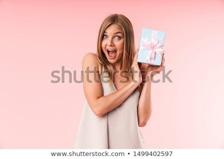 Gyönyörű boldog fiatal érzelmes nő pózol Stock fotó © deandrobot
