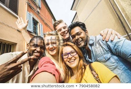 group of happy international friends taking selfie stock photo © dolgachov