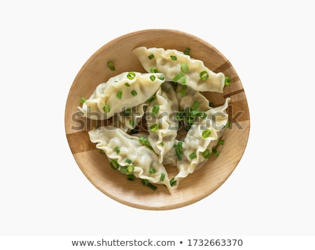 Delicious chinese dumplings served on wooden plate Stock photo © dash