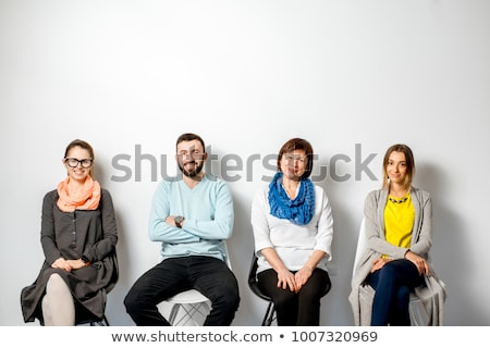 smiling young casual man waiting for a job interview stock photo © feedough