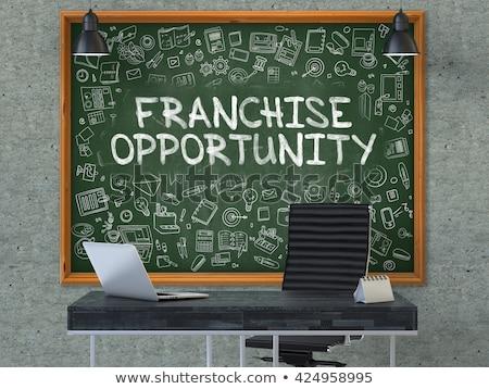 Franchise Opportunity Drawn on Brick Wall. 3d. Stock photo © tashatuvango