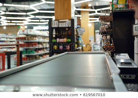 Cashier at cash desk in supermarket Stock photo © jossdiim