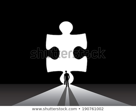 businessman standing in front of a big puzzle piece stock photo © ra2studio