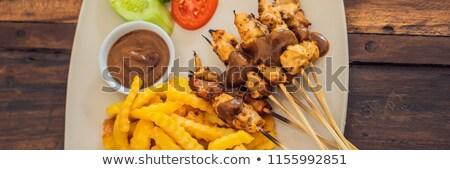 tyúk · ázsiai · stílus · földimogyoró · tányér · hús - stock fotó © galitskaya