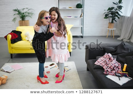 teenage girls singing to hairbrush and having fun Stock photo © dolgachov