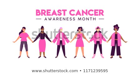 Hope text and pink breast cancer awareness women holding card Stock photo © wavebreak_media