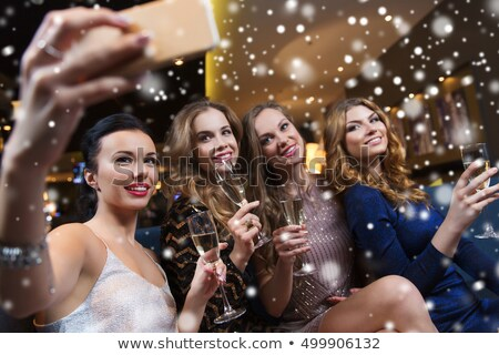 smiling female friends taking selfie with wine glass in night club stock photo © wavebreak_media