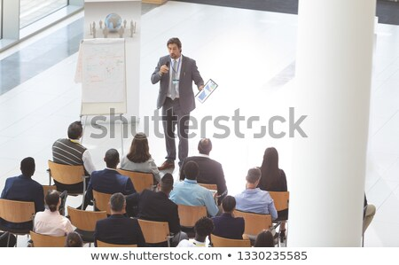 High angle view of middle-aged Caucasian businessman speaking in front of group of  diverse business Stock photo © wavebreak_media