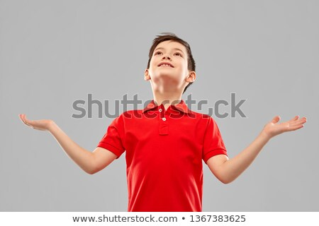happy grateful boy in red t-shirt looking up Stock photo © dolgachov