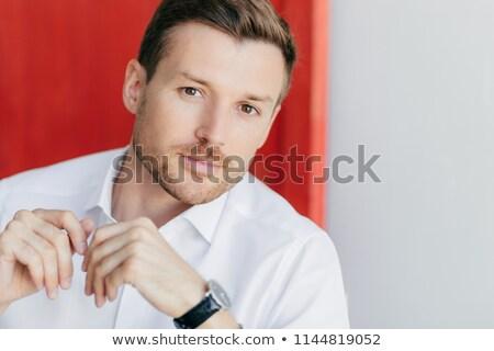 Kép figyelmes férfi vállalkozó fehér póló Stock fotó © vkstudio