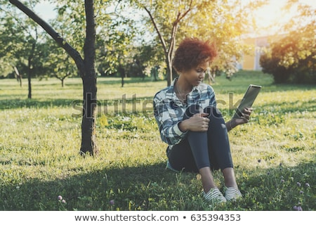 menina · leitura · ebook · sessão · grama · céu - foto stock © AndreyKr