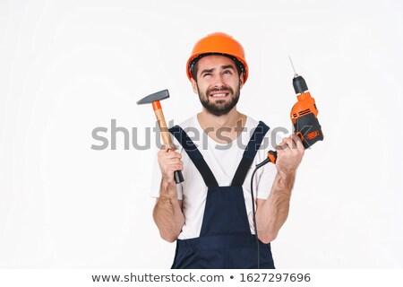 Negatieve denken jonge man boor hamer Stockfoto © deandrobot