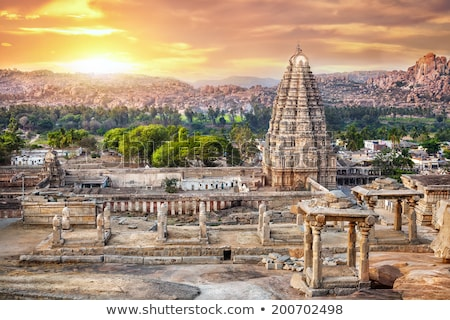 Antigo ruínas pôr do sol Índia acima bazar Foto stock © dmitry_rukhlenko