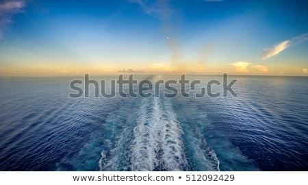 Vitorlázik messze föld mögött égbolt víz Stock fotó © lithian