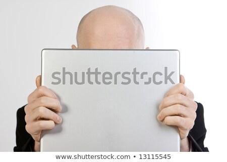 üzletember · rejtőzködik · mögött · laptop · fej · munkahely - stock fotó © dacasdo