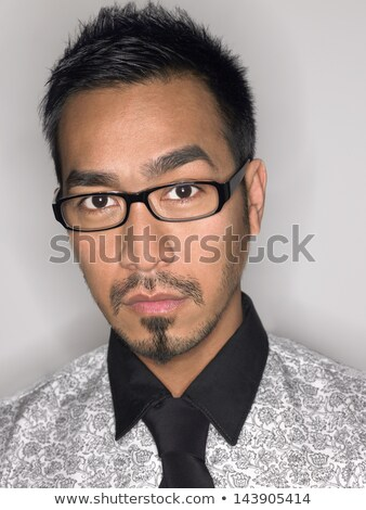 closeup portrait of a asian young man wearing spectacles against stock photo © cozyta