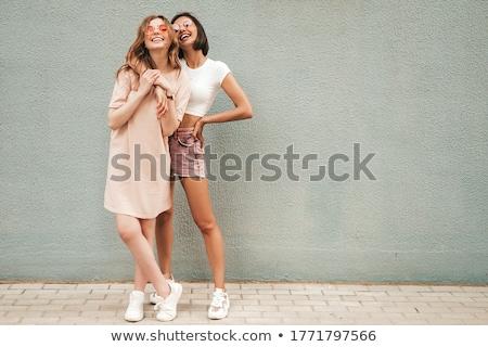 Genç seksi poz beyaz gülümseme Stok fotoğraf © yurok